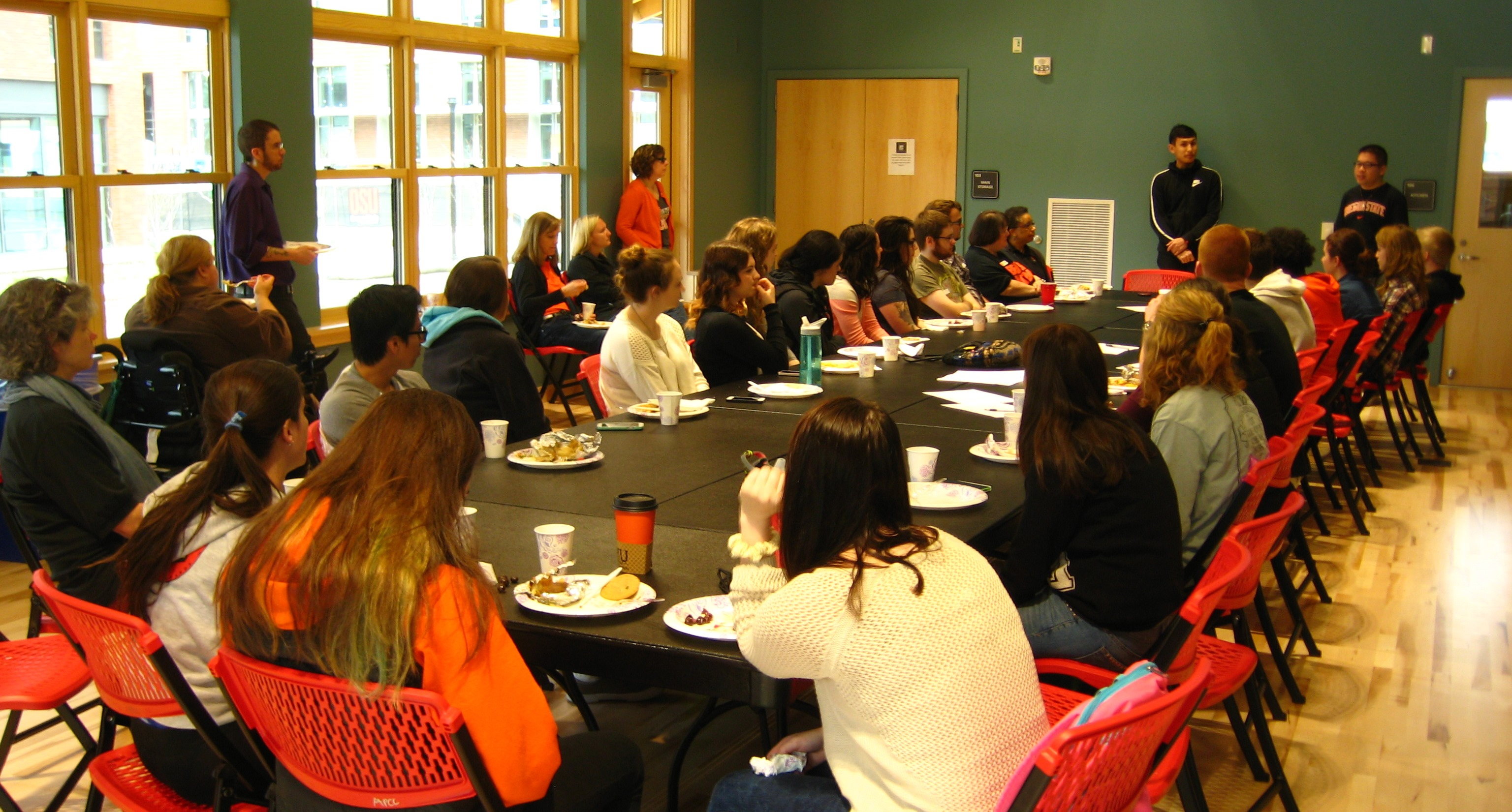 DAS Student workers and staff listen to a presentation at the new Asian Pacific Cultural Center