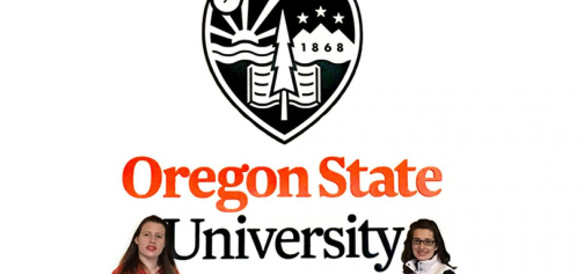 Hanna and Jordana standing infront of a large Oregon State logo